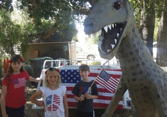 Dino, flags, trailer for 4th of July Parade