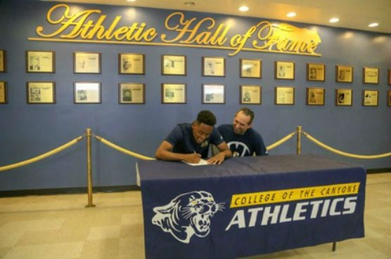 College of the Canyons men's basketball player Robert Moss, pictured with COC head coach Howard Fisher, has committed to continue his career at University of Saint Katherine in San Marcos, Calif. Photo: Jesse Muñoz/COC Sports Information Director