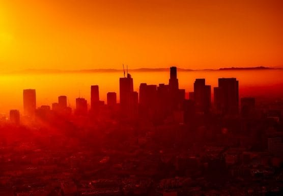 Los Angeles skyline, sunset, smoggy.