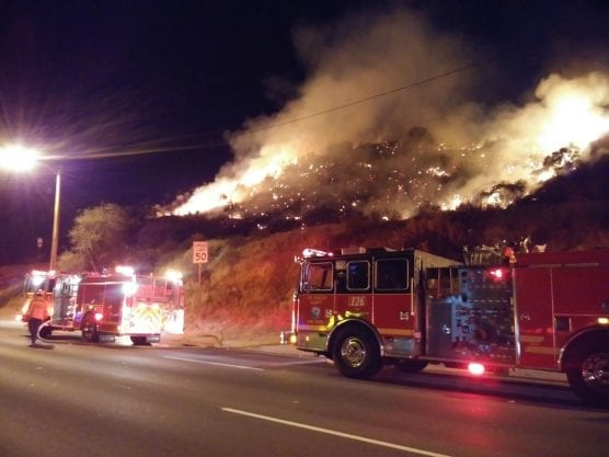 Firefighters battle two-acre brush fire in Saugus, dubbed the Soledad Incident, Wednesday night. Photo:  Kevin Gilley/Two8Nine Media.