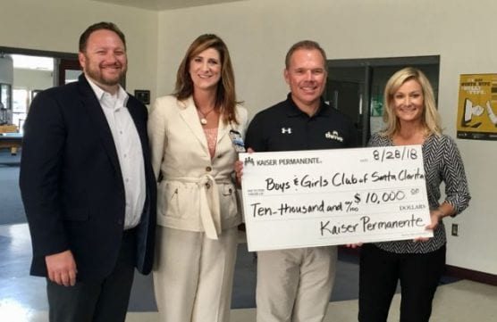 Amy Wiese, community benefit manager, Kaiser Permanente Panorama City Medical Center, presents a check of $10,000 in community benefit funding to the Boys and Girls Club of Santa Clarita Valley.