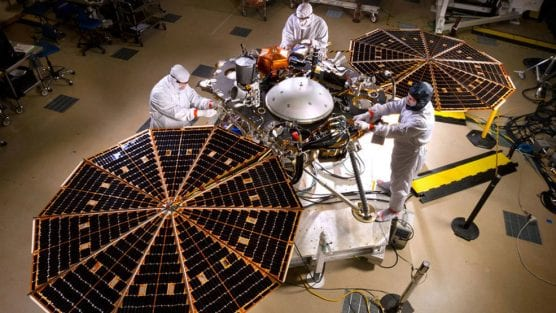 NASA's InSight Mars Lander in fully landed configuration in the clean room at Lockheed Martin Space in Littleton, Colorado. Once the solar arrays are fully deployed on Mars, they can provide 600-700 watts on a clear day, or just enough to power a household blender. Credits: Lockheed Martin.