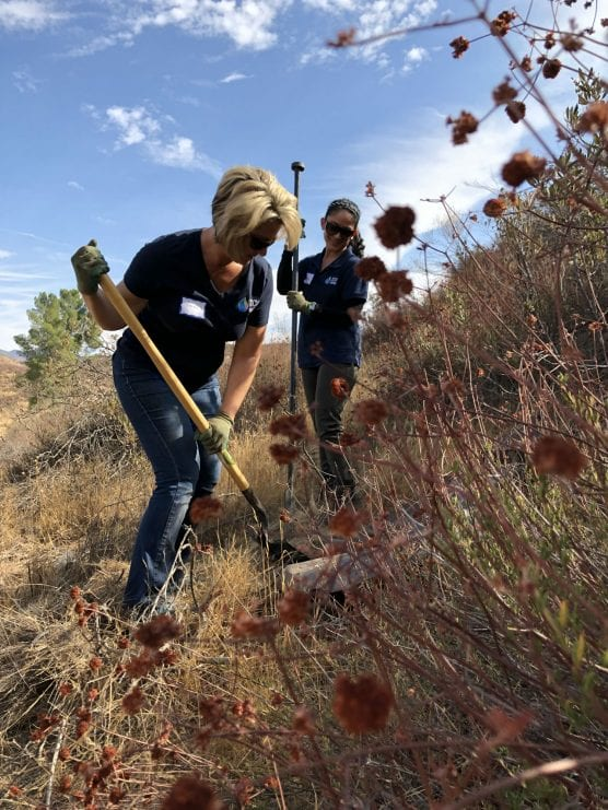 Karen Denkinger and Jenny Joo, employees of SCV Water, assist with habitat restoration in San Francisquito Canyon.