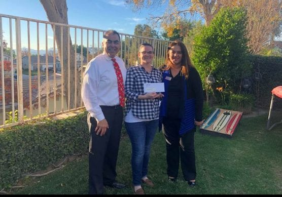 Golden Valley High School Principal Sal Freas (left) with Teacher Jaime Foderaro (center) as she receives a $500 California Credit Union Teacher Grant from Mariam Nasiry (right), Senior School & Community Development Officer, California Credit Union.