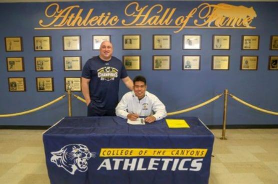 Michael Nacnac signs with Clarke University.   Photo: Jesse Munoz, COC SID