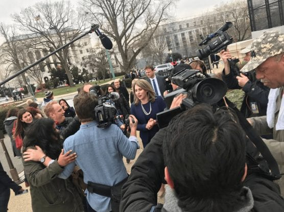 Hill addresses the media outside the Capitol Building after she had been sworn in Thursday, January 3, 2018. Photo courtesy of the office of Katie Hill. - mid-year report
