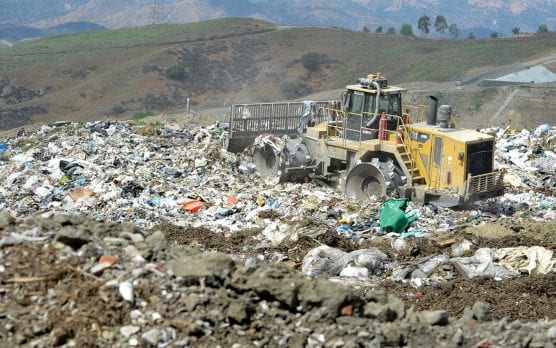 "A compactor rolls over the exposed trash at a 200X200 foot ""working face"" site at the Chiquita Canyon Landfill in Castaic on Nov. 2, 2016. As soon as the trash is spread and compacted it is immediately covered with dirt and the working face site moves forward. This view looks southwest toward the new proposed expansion site, and in the distance is the tall ridge which blocks the landfill from view of surrounding communities. 