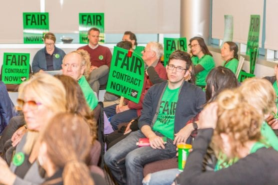 "Teachers crowd the College of the Canyons board room with shirts and signs demanding a ""fair contract now!"" prior to a board meeting Wednesday evening. 