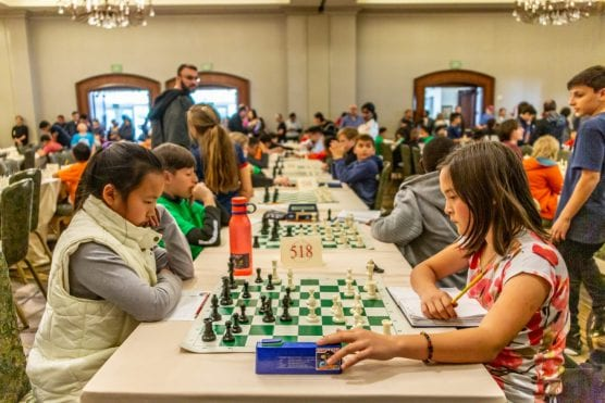 Two competitors engage in a battle of wit at the Southern California State Scholastic Chess Championship at the Hyatt in Valencia Sunday afternoon. | Photo: Cory Rubion/The Signal.