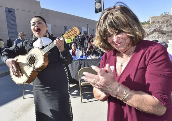 Raquel Guerrera, right, applauds after singing along with Wendy Alarcon of Mariachi Las Catrinas at the Golden Valley High School Quinceanera, celebrating 15 years of growth and excellence held at Golden Valley High School in Santa Clarita on Saturday. | Photo: Dan Watson/The Signal.