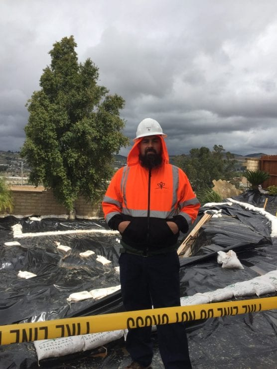 Workers including Matthew Aragon of Landscape Development have been continuously pumping rainwater out of the affected backyards on Terri Drive in Canyon Country to prevent further land degradation. | Photo: Matt Fernandez/The Signal.