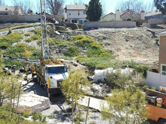 A drilling rig takes soil samples behind homes on Trestles Drive on Tuesday. | Photo: Dan Watson/The Signal.