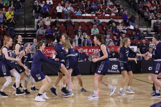 The Mustangs celebrate Friday's win over MidAmerica Nazarene in the NAIA D1 Round of 16 in Billings, Montana.