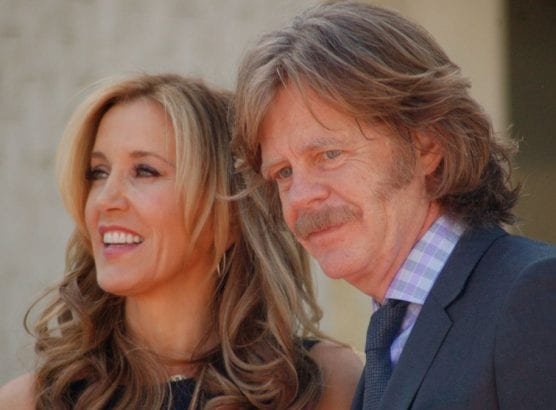 Felicity Huffman and husband William H. Macy at a ceremony for Huffman and Macy to receive a star on the Hollywood Walk of Fame on March 7, 2012. Macy is not charged in the college admissions scandal. | Photo: Angela George/WMC 3.0.
