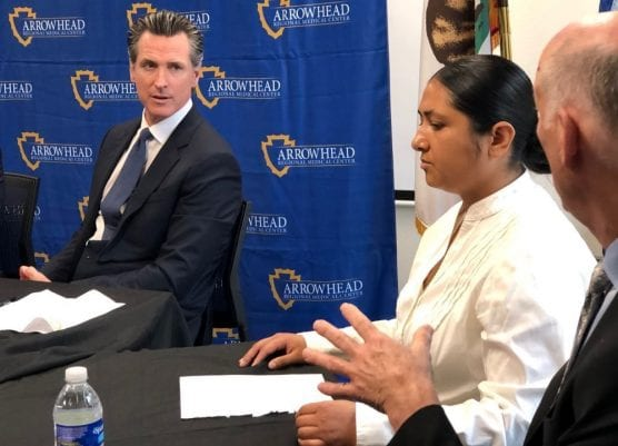 California Gov. Gavin Newsom speaks with Michelle Padilla, center, and Tod Lipka, right, about his revised state budget proposal that would boost funds for mental health services and emergency shelters for the homeless. | Photo: Martin Macias Jr./CNS.