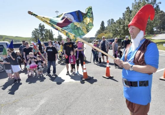 Jim D'Addario, right, raises the flag to start the Gnome Parade during the Castaic Lake Dam Run & Gnome Festival held at Castaic Lake in Castaic on Saturday. | Photo: Dan Watson/The Signal.