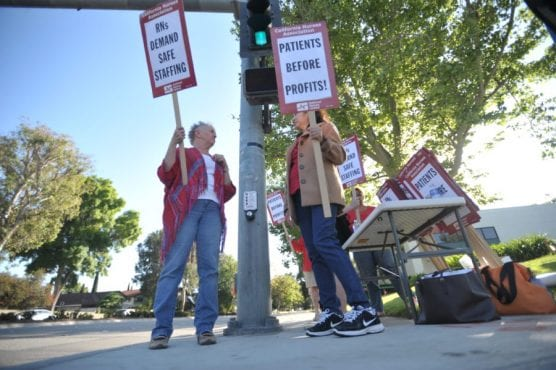 Nurses and their supporters picket near Henry Mayo Newhall Hospital in 2015. Signal photo by Katharine Lotze.