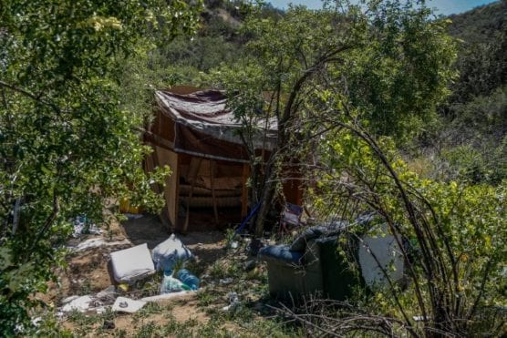 FILE PHOTO. A homeless camp photographed in April 2018 inside private property in the hills behind the 23600 block of Diamond Place. Cory Rubin/The Signal.