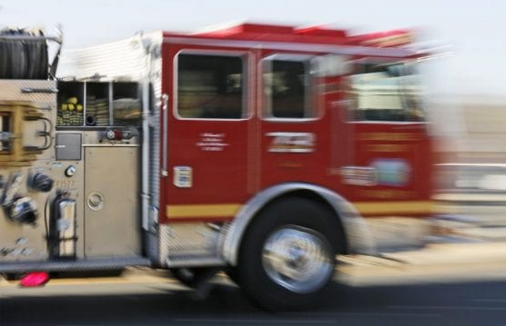 A Los Angeles County Fire Department truck moves quickly to an emergency - oil. Katharine Lotze/The Signal (File photo).