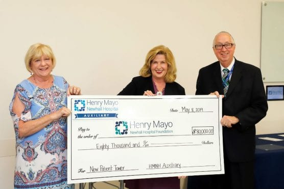 Henry Mayo Newhall Hospital Auxiliary President Mimi Baum, Henry Mayo Newhall Hospital Foundation President Marlee Lauffer, and  Henry Mayo Newhall Hospital President/CEO Roger Seaver with check toward new patient tower.