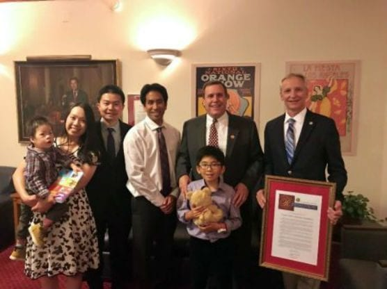 Kiran Dong (front and center, with teddy bear) is pictured with (from left): Timothy Zhang (baby); Richard Zhang and Grace Chen (parents); Rodney Zhang (white shirt); PWCF Board Member Senator Scott Wilk; ; and Roger Goatcher, PWCF Board President.