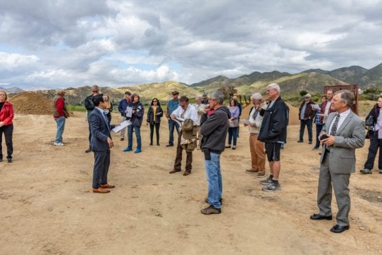 Associate Planner Hai Nguyen speaks to a crowd as he gives a tour of the site of the proposed Sand Canyon Country Club on Tuesday afternoon. | Photo: Cory Rubin/The Signal.