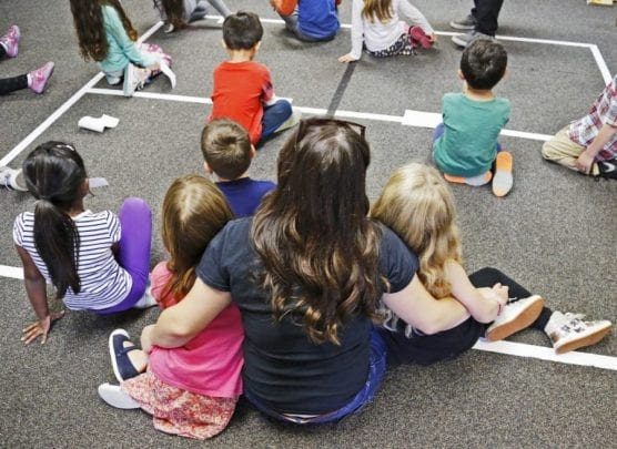 Kids sit close to a counselor during an activity teaching kindness at Saugus High School's Students Matter Club's Sunshine Day Camp at Stevenson Ranch Elementary School on Friday, April 7, 2017. File photo by Katharine Lotze/The Signal.