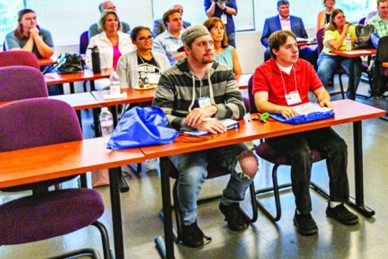 Students look on at the inaugural orientation for College of the Canyons' and Carousel Ranch's Ready to Work Academy at the Dr. Dianne G. Van Hook University Center Tuesday afternoon. | Photo: Cory Rubin/The Signal.