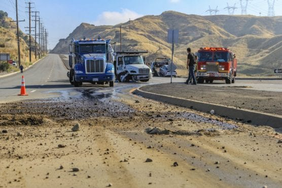 A traffic collision involving two semi trucks and an electric vehicle caused a fuel spill on Sierra Highway in Newhall Monday morning. | Photo: Lorena Mejia/The Signal.