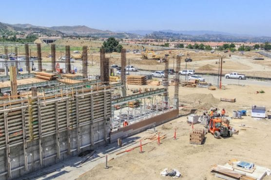 Vista Canyon parking structure under construction with luxury apartment site in the distance. | Photo: Lorena Mejia/The Signal.