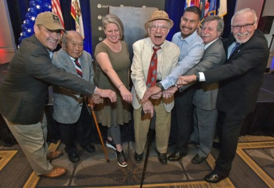 Honored veterans from left, David Jackson, Toshiaki Watanabe, Gretchen Zovak, Mario Aquilani, Michael Reyes, Jack Crawford and Ronald Boudreaux pose for photos after the 9th Annual Patriots Luncheon presented by the Santa Clarita Valley Chamber of Commerce and the city of Santa Clarita at the Hyatt Regency Valencia on Thursday. | Photo: Dan Watson/The Signal.