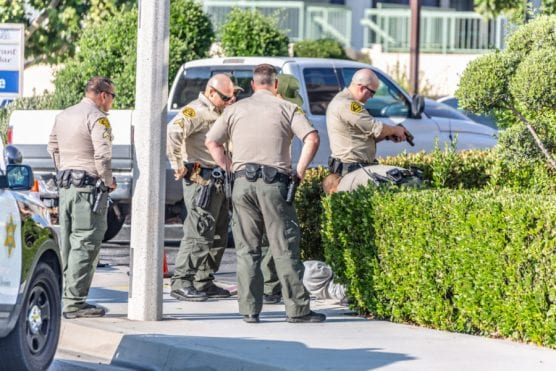 Los Angeles County Sheriff's deputies detain three males at gunpoint in connection with a reported firearm at the corner of Sierra Highway and Dolan Way in Canyon Country Sunday evening. | Photo: Cory Rubin/The Signal.