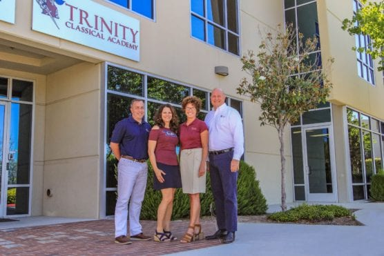 Trinity Classical Academy administrators stand in front of the recently purchased location on Kelly Johnson Parkway in Valencia. | Photo: Lorena Mejia/The Signal.