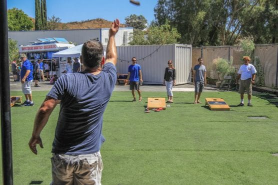 Tom O'Brien aims a shot at the Avenues SLS annual cornhole tournament and FUNdraiser at Wolf Creek Brewery. | Photo: Ryan Mancini/The Signal.
