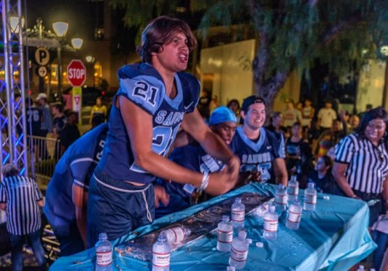 Saugus junior Julian Bornn reacts to finishing the four-foot burrito with four of his teammates at the 10th annual Burrito Bowl at the Westfield Valencia Town Center Tuesday night. | Photo: Cory Rubin/The Signal.