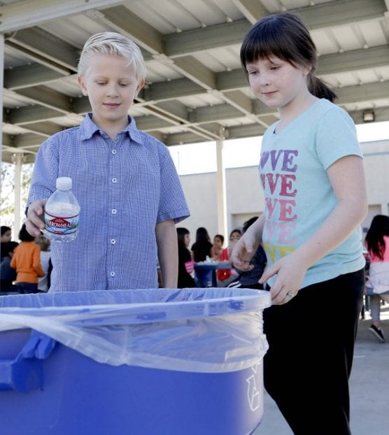 rePlanet closes - Robert Hill and Julie Barlow recycle their water bottles at Rio Vista Elementary School on Thursday, Nov. 30, 2017. Water bottles have been made by the available Santa Clarita Valley School Food Service Agency for students to drink from.   Photo: Nikolas Samuels/The Signal.