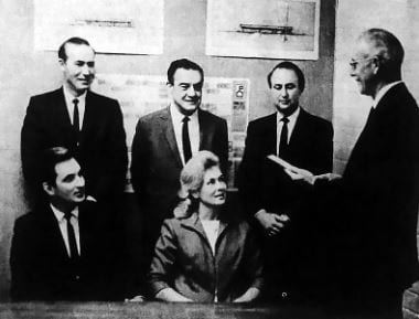 Dr. Fred Bewley (right), Los Angeles County's assistant superintendent of schools, swears in the new college district's first Board of Trustees: (standing, from left) Dr. William G. Bonelli Jr., Edward Muhl and Peter Huntsinger, and (seated) Bruce Fortine and Sheila Dyer. The ceremony took place in the William S. Hart Union High School District's board room on Dec. 11, 1967.