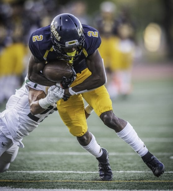 College of the Canyons' Alonzell Henderson is brought down by Grossmont College's Joel Mewis after getting a first down in the first half Saturday, September 14, 2019 at COC. The Cougars beat Grossmont 41-13. Henderson had seven receptions for 101 yards and a touchdown in the win for Canyons. | Photo: Kevin Karzin.
