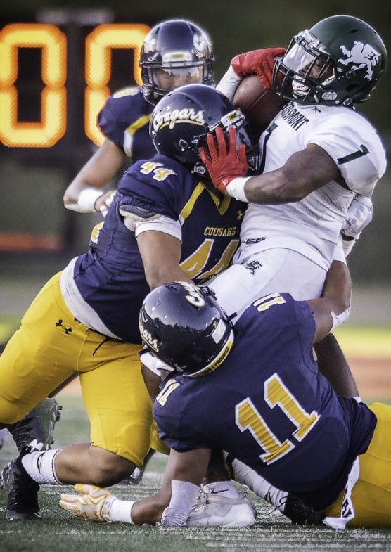 gallery - College of the Canyons' Julian Salazar (44), and Ryan Haith (11), wrap up Grossmont College's Jarius Burnette (1) for a loss Saturday, September 14, 2019 at COC Stadium. The Cougars held Grossmont to 50 rushing yards as the Griffins fell to the Cougars 41-13. | Photo: Kevin Karzin.
