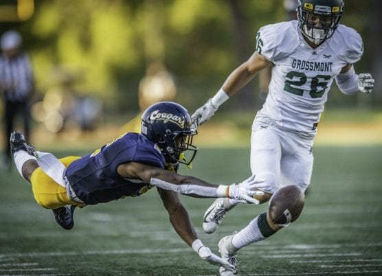 gallery - College of the Canyons' Alonzell Henderson (2) dives for the ball on a pass attempt by quarterback Armani Edden as Grossmont College's Derek Sutherland covers Saturday, September 14, 2019 at COC Stadium. Canyons won the game 41-13. | Photo: Kevin Karzin.