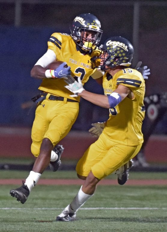 College of the Canyons' Alonzell Henderson (2) celebrates with teammate Trey Longstreth (15) as Henderson runs in an 87-yard touchdown in the second quarter against Cerritos College at COC on Saturday. | Photo: Dan Watson/The Signal.
