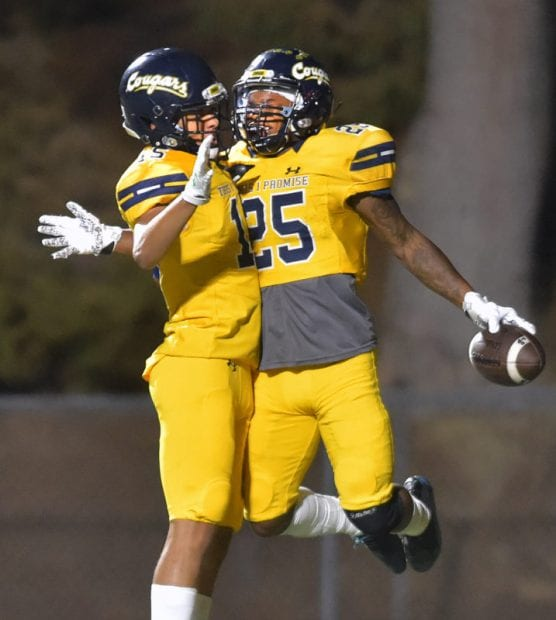 College of the Canyons' Jordan Anderson (25) celebrates his touchdown with teammate Trey Longstreth (15) against Cerritos College at COC on Saturday. | Photo: Dan Watson/The Signal.