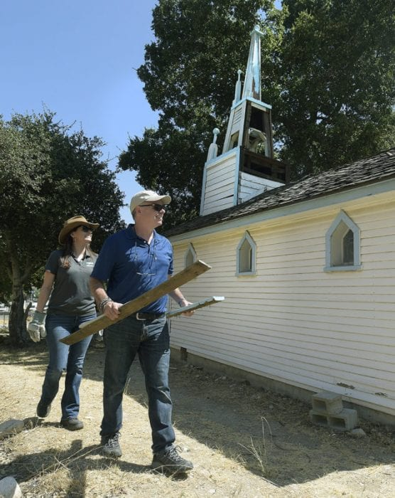 Michelle Tucker, left, and Marcelo Cairo of Inertia Engineers discuss damaged pieces taken from the steeple atop the Ramona Chapel, seen behind them at Heritage Junction in Newhall on Wednesday, September 11, 2019. | Photo: Dan Watson/The Signal.
