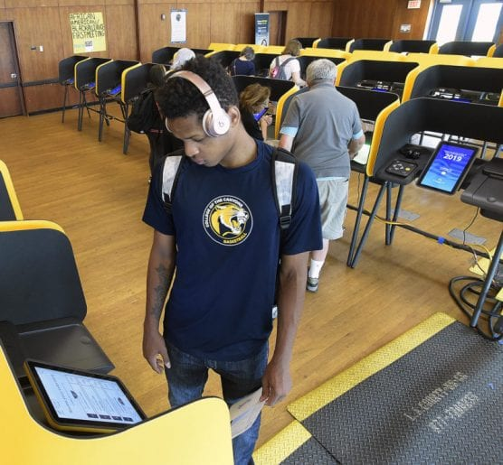 College of the Canyons student Jah-Kez Moore, 19, reads the prompts on the screen and uses the headphones in the electronic booth during a mock election held at College of the Canyons in Valencia on Saturday, September 28, 2019. | Photo: Dan Watson/The Signal.