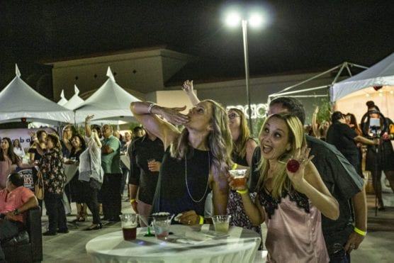 "Guests enjoy a sampling of food and drinks from local eateries at ""Cocktails on The Roof,"" an event benefiting the WiSH Foundation, on September 6, 2019. 