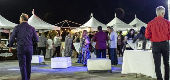 """Guests enjoy a sampling of food and drinks from local eateries at """"Cocktails on The Roof,"""" an event benefiting the WiSH Foundation, on September 6, 2019. 