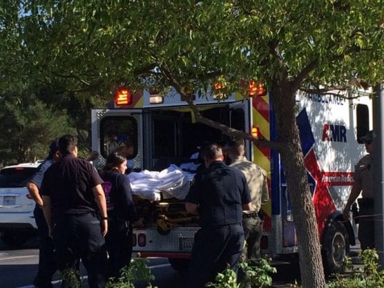 Paramedics place a patient in an ambulance at the Westfield Valencia Town Center mall on Monday afternoon. | Photo: Maureen Daniels/The Signal.