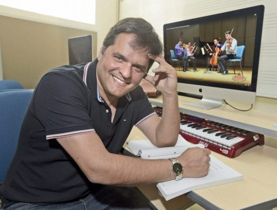 College of the Canyons professor and Grammy-winning composer Yalil Guerra, nominated for an 8th Latin Grammy in 2019, is pictured in his office at COC on Wednesday, October 10, 2018. | Photo: Dan Watson/The Signal.