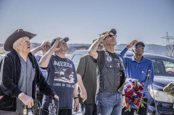 Veterans salute during the flag ceremony at the Bella Vida Senior Center's Veterans tribute event on November 8, 2019.   Photo: Bobby Block / The Signal.