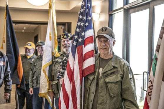 Jerry Rhodes leads the procession of flags for the opening ceremony of the Bella Vida Senior Center's Veterans Tribute event late Friday morning, November 8, 2019.   Photo: Bobby Block / The Signal.